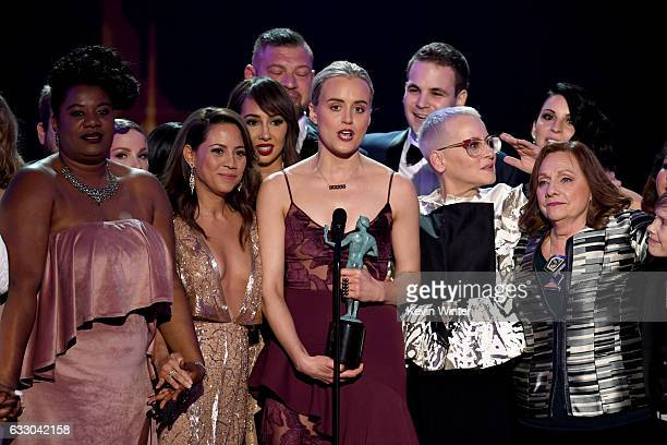 Actor Taylor Schilling and cast of 'Orange Is the New Black' accept Outstanding Performance by an Ensemble in a Comedy Series onstage during The 23rd...