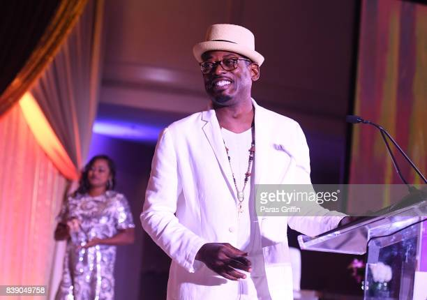 Actor TC Carson speak onstage at 2017 BronzeLens Women SuperStars Luncheon at Westin Peachtree Plaza on August 25 2017 in Atlanta Georgia