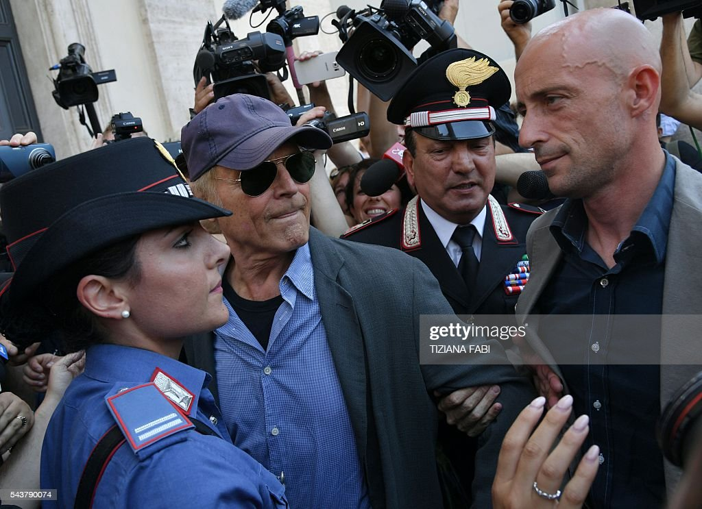 Actor Terence Hill (C), whose real name is Mario Girotti, leaves after the funeral of Italian actor Bud Spencer, born Carlo Pedersoli, at the 'church of the artists', Santa Maria in Montesanto, on June 30, 2016 at Piazza del Popolo in Rome. Bud Spencer who starred in a string of spaghetti westerns, died on June 27 in Rome aged 86. Spencer, born in Italy in 1929, played in 16 films alongside Terence Hill. / AFP / TIZIANA