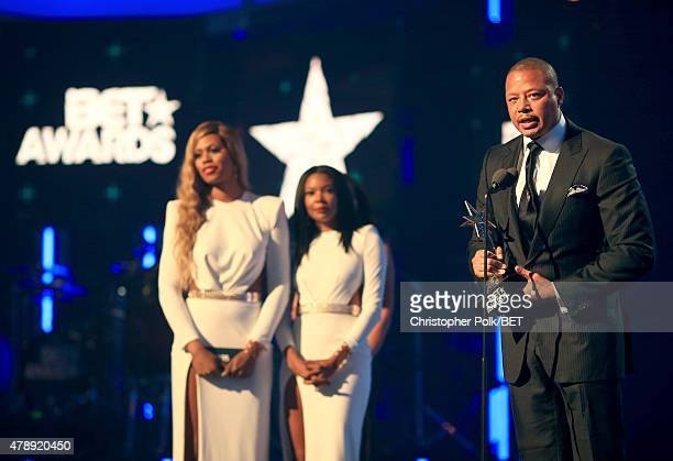 Actor Terrence Howard accepts the Best Actor award from actresses Laverne Cox and Gabrielle Union onstage during the 2015 BET Awards at the Microsoft...