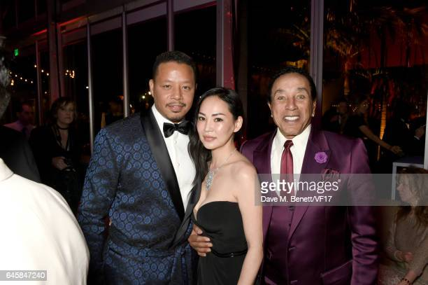 Actor Terrence Howard Miranda Pak and singer Smokey Robinson attend the 2017 Vanity Fair Oscar Party hosted by Graydon Carter at Wallis Annenberg...