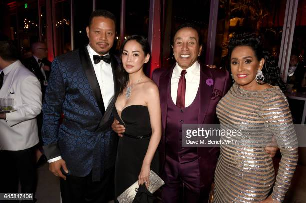 Actor Terrence Howard Miranda Pak singer Smokey Robinson and Frances Glandney attend the 2017 Vanity Fair Oscar Party hosted by Graydon Carter at...