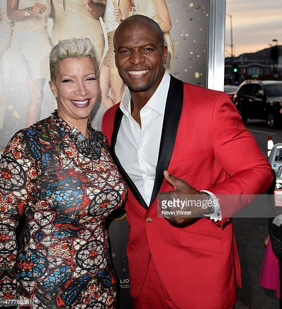 Actor Terry Crews and his wife Rebecca KingCrews arrive at the premiere of Tyler Perry's 'The Single Moms Club' at the Cinerama Dome on March 10 2014...