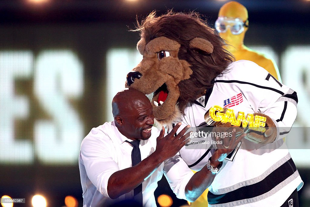 Actor <a gi-track='captionPersonalityLinkClicked' href=/galleries/search?phrase=Terry+Crews&family=editorial&specificpeople=569932 ng-click='$event.stopPropagation()'>Terry Crews</a> and Los Angeles Kings mascot Bailey the Lion accepts the Most Awesome Mascot award onstage 4th Annual Cartoon Network Hall Of Game Awards held at the Barker Hangar on February 15, 2014 in Santa Monica, California.