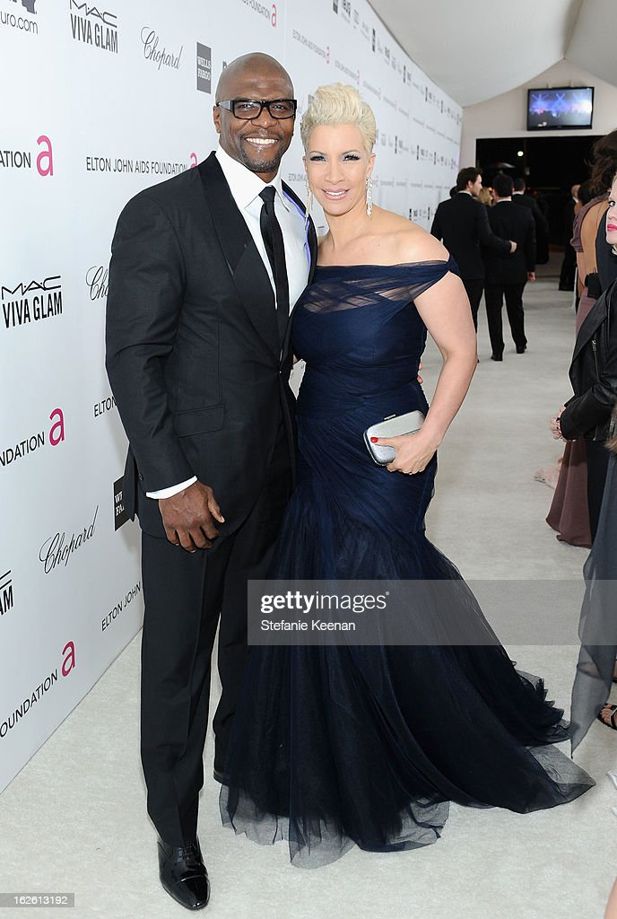 Actor Terry Crews and Rebecca King-Crews attend Chopard at 21st Annual Elton John AIDS Foundation Academy Awards Viewing Party at West Hollywood Park on February 24, 2013 in West Hollywood, California.