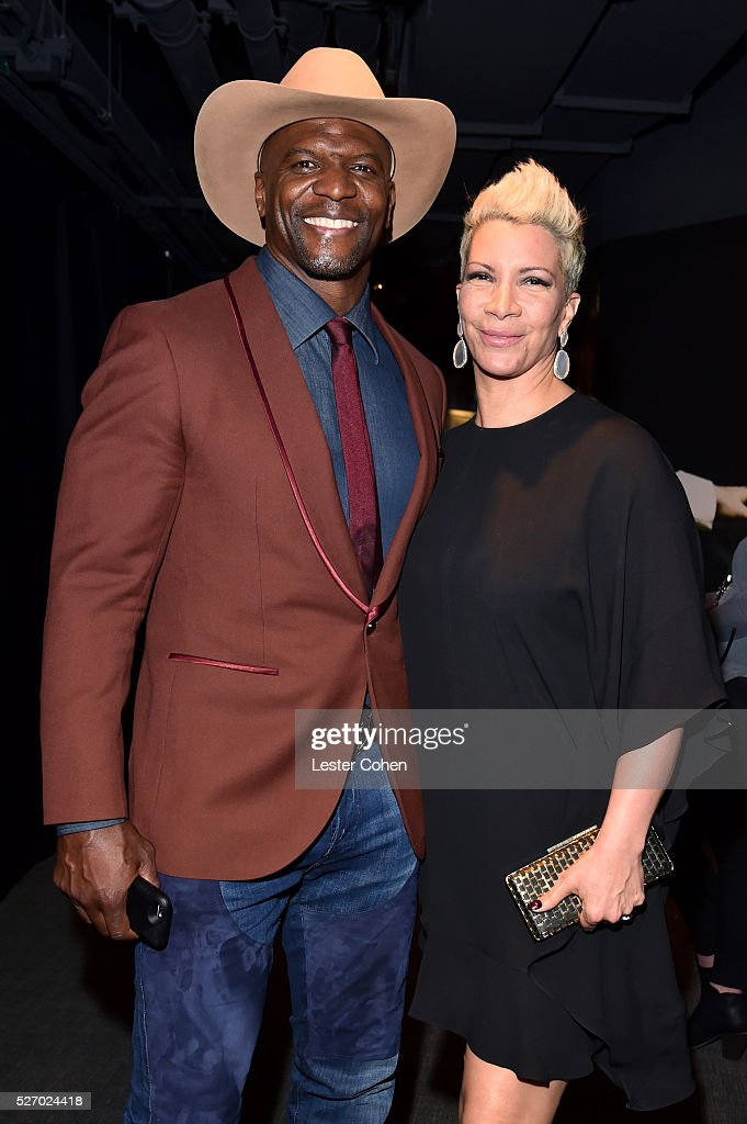 Actor <a gi-track='captionPersonalityLinkClicked' href=/galleries/search?phrase=Terry+Crews&family=editorial&specificpeople=569932 ng-click='$event.stopPropagation()'>Terry Crews</a> (L) and Rebecca King-Crews attend the 2016 American Country Countdown Awards at The Forum on May 1, 2016 in Inglewood, California.