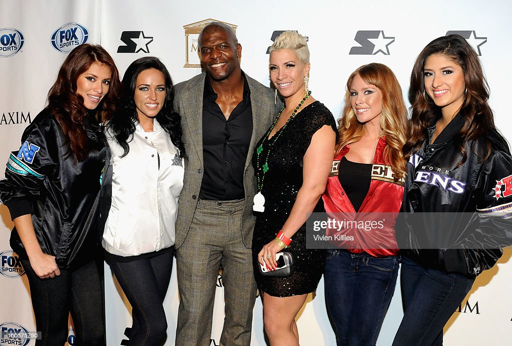 Actor <a gi-track='captionPersonalityLinkClicked' href=/galleries/search?phrase=Terry+Crews&family=editorial&specificpeople=569932 ng-click='$event.stopPropagation()'>Terry Crews</a> and Rebecca King-Crews (C) pose on the Starter Red Carpet at the Maxim Party during Super Bowl XLVII at Second Line Warehouse on February 2, 2013 in New Orleans, Louisiana.