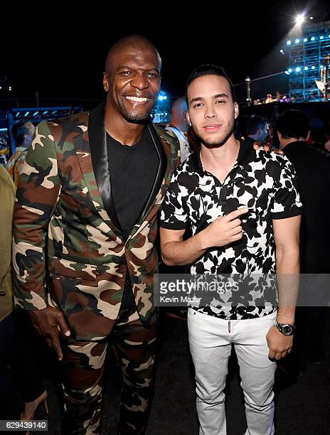 Actor Terry Crews and singer Prince Royce pose backstage at 'Spike's Rock the Troops' event held at Joint Base Pearl Harbor Hickam on October 22 2016...