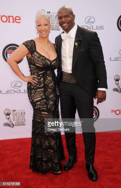 Actor Terry Crews and wife Rebecca Crews arrive at the 45th NAACP Image Awards at Pasadena Civic Auditorium on February 22 2014 in Pasadena California