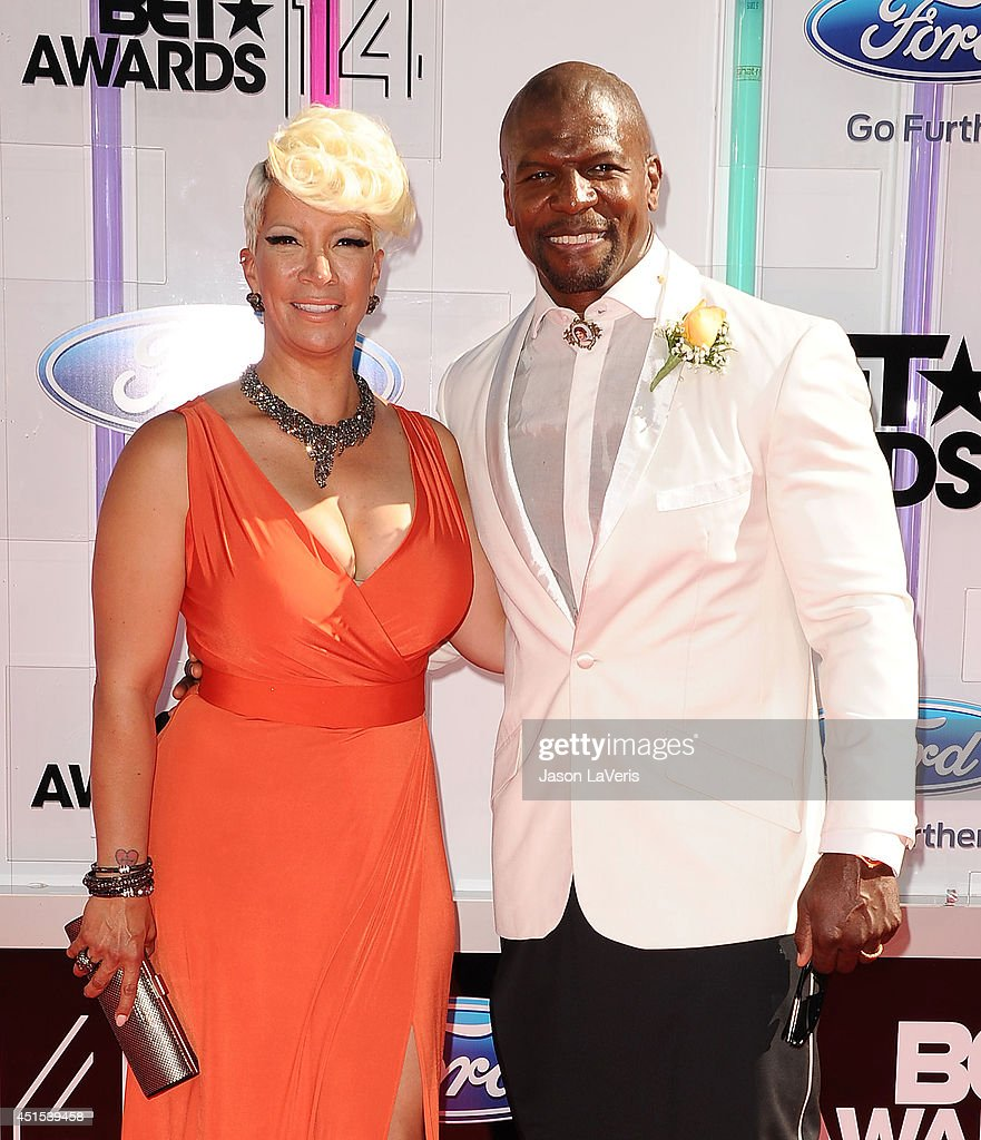 Actor <a gi-track='captionPersonalityLinkClicked' href=/galleries/search?phrase=Terry+Crews&family=editorial&specificpeople=569932 ng-click='$event.stopPropagation()'>Terry Crews</a> (R) and wife Rebecca King Crews attend the 2014 BET Awards at Nokia Plaza L.A. LIVE on June 29, 2014 in Los Angeles, California.