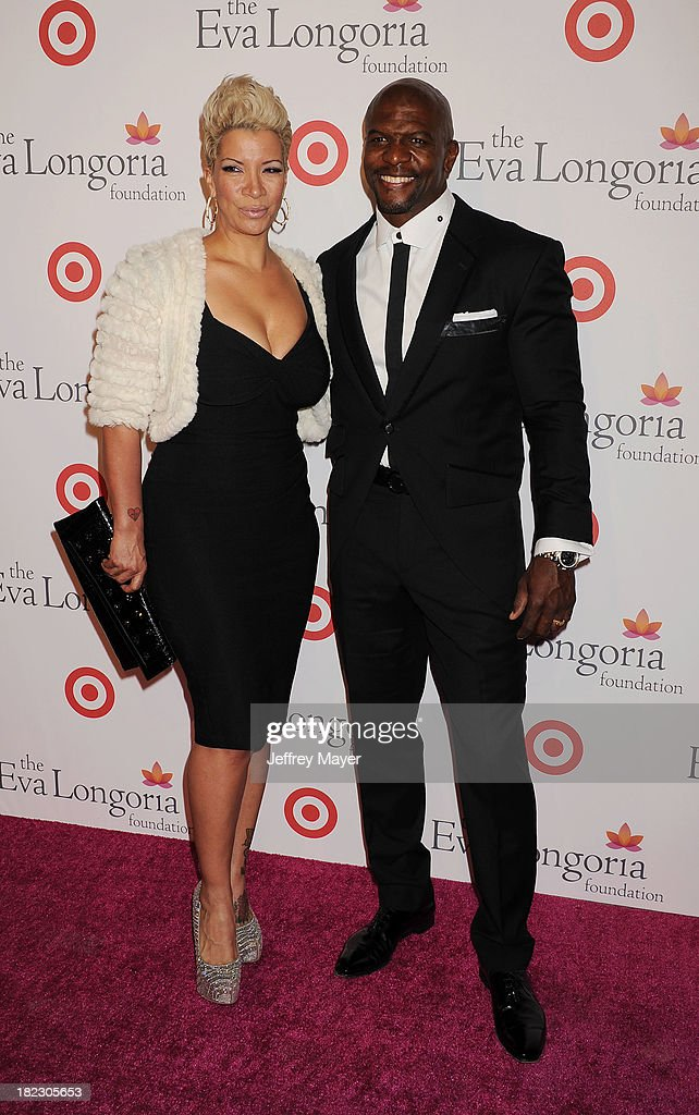 Actor <a gi-track='captionPersonalityLinkClicked' href=/galleries/search?phrase=Terry+Crews&family=editorial&specificpeople=569932 ng-click='$event.stopPropagation()'>Terry Crews</a> (R) and wife Rebecca King-Crews arrive at the Eva Longoria Foundation Dinner at Beso restaurant on September 28, 2013 in Hollywood, California.