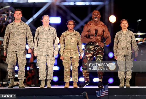 Actor Terry Crews with service men and women performs onstage during 'Spike's Rock the Troops' event held at Joint Base Pearl Harbor Hickam on...