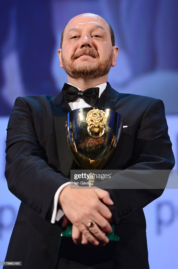 Actor Themis Panou accepts the Best Actor Award for 'Miss Violence' on stage during the Closing Ceremony at the 70th Venice International Film Festival at the Palazzo del Casino on September 7, 2013 in Venice, Italy.
