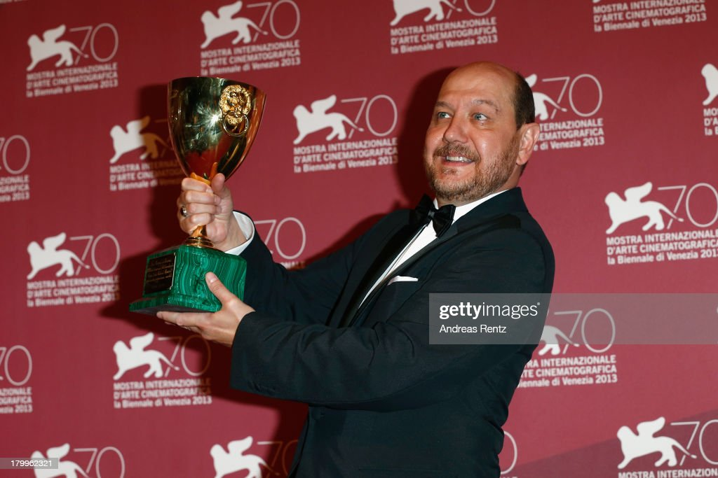 Actor Themis Panou poses with the Best Actor Award he received for his role in the movie 'Miss Violence' as he attends the Award Winners Photocall during the 70th Venice International Film Festival at Palazzo del Casino on September 7, 2013 in Venice, Italy.