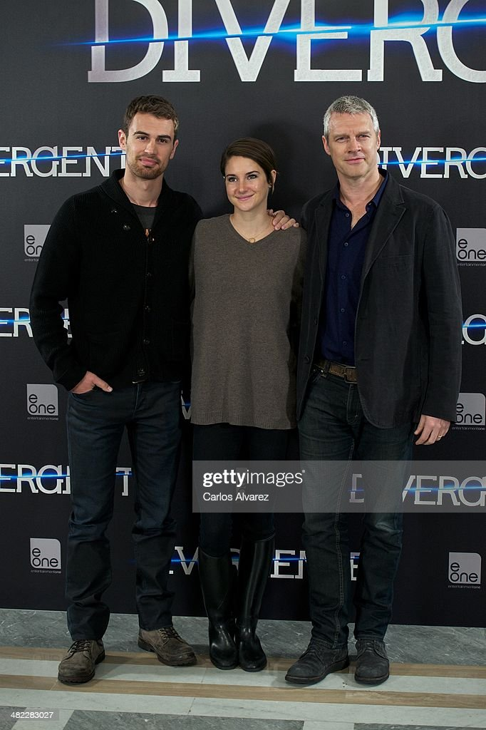 Actor Theo James actress Shailene Woodley and director Neil Burger attend the 'Divergent' photocall at the Villamagna Hotel on April 3 2014 in Madrid...