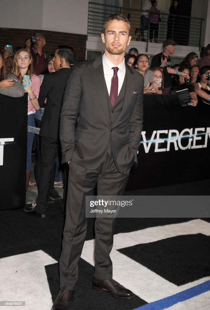 Actor <a gi-track='captionPersonalityLinkClicked' href=/galleries/search?phrase=Theo+James&family=editorial&specificpeople=7989783 ng-click='$event.stopPropagation()'>Theo James</a> arrives at the Los Angeles premiere of 'Divergent' at Regency Bruin Theatre on March 18, 2014 in Los Angeles, California.