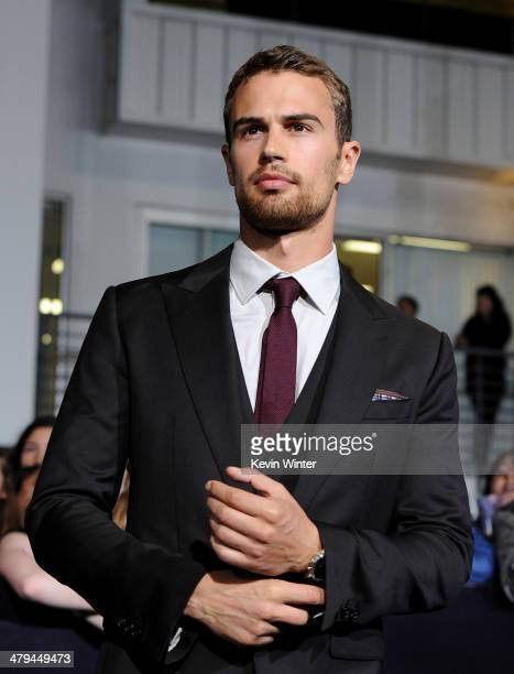 Actor Theo James arrives at the premiere of Summit Entertainment's 'Divergent' at the Regency Bruin Theatre on March 18 2014 in Los Angeles California