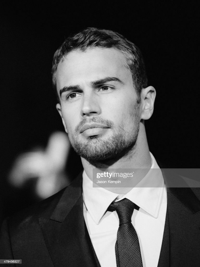 Actor <a gi-track='captionPersonalityLinkClicked' href=/galleries/search?phrase=Theo+James&family=editorial&specificpeople=7989783 ng-click='$event.stopPropagation()'>Theo James</a> attends Summit Entertainment's 'Divergent' Premiere at Regency Bruin Theatre on March 18, 2014 in Los Angeles, California.