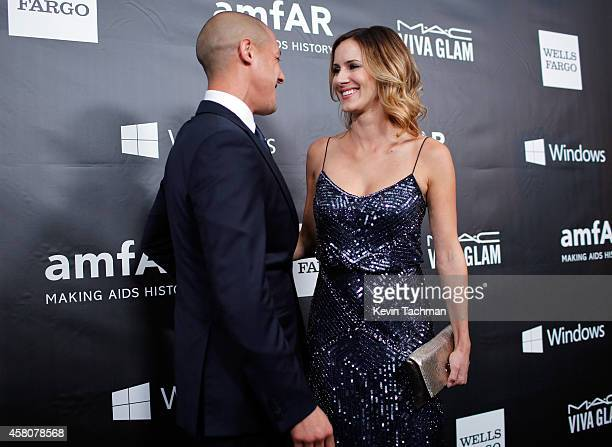 Actor Theo Rossi and Meghan McDermott attend amfAR LA Inspiration Gala honoring Tom Ford at Milk Studios on October 29 2014 in Hollywood California
