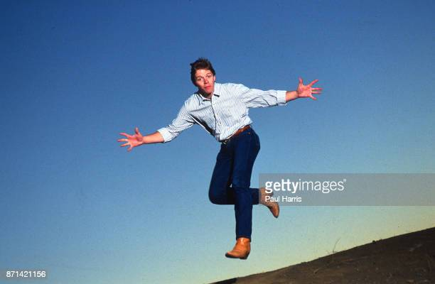 Actor Thomas F Wilson who played Biff Tannen in the 1985 film Back To The Future leaps in the air on February 24 1990 in the Santa Monica Mountains...