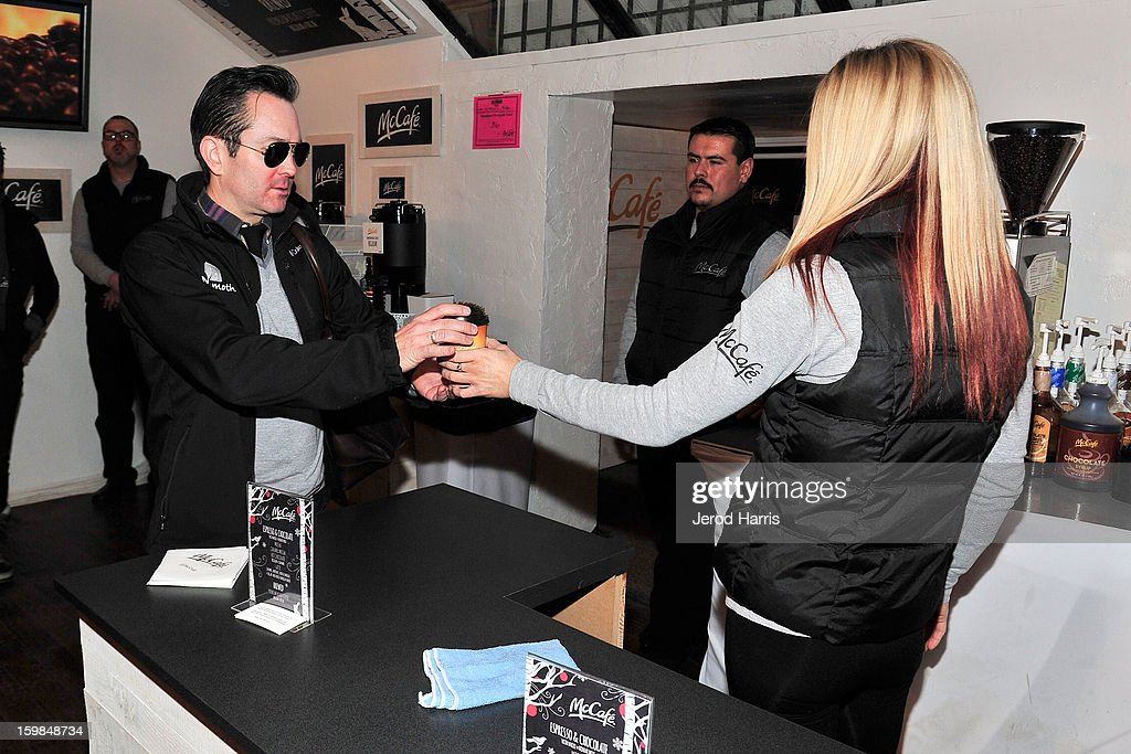 Actor Thomas Lennon (L) warms up at the McDonald's McCafe at Sundance on January 21, 2013 in Park City, Utah.