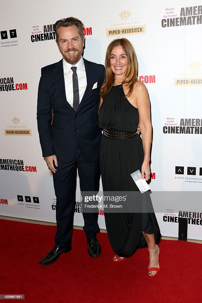 Actor Thomas Mikusz (L) and Elvi Cano arrive at the 27th American Cinematheque Award honoring Jerry Bruckheimer at The Beverly Hilton Hotel on December 12, 2013 in Beverly Hills, California.
