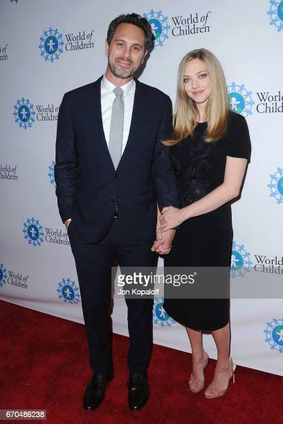 Actor Thomas Sadoski and wife actress Amanda Seyfried arrive at the 2017 World Of Children Hero Awards at Montage Beverly Hills on April 19 2017 in...