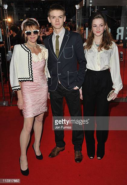Actor Thomas Sangster with his mother Pascha and sister Eva as they attend the 'Remember Me' film premiere at the Odeon Leicester Square on March 17...