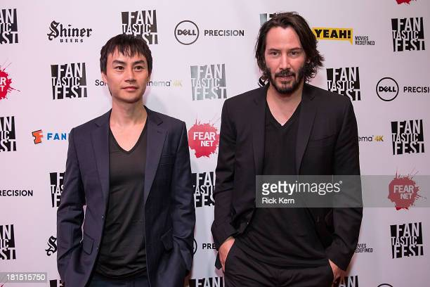Actor Tiger Hu Chen and director/actor Keanu Reeves arrive at the premiere of 'Man of Tai Chi' during Fantastic Fest at the Alamo Drafthouse on...