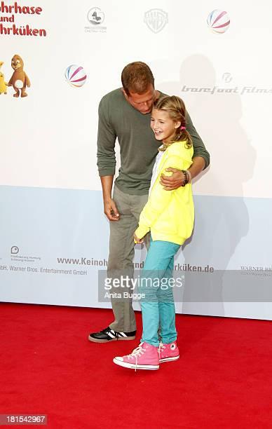 Actor Til Schweiger and Emma Schweiger attend the premiere of the film 'Keinohrhase und Zweiohrkueken' at CineStar on September 22 2013 in Berlin...