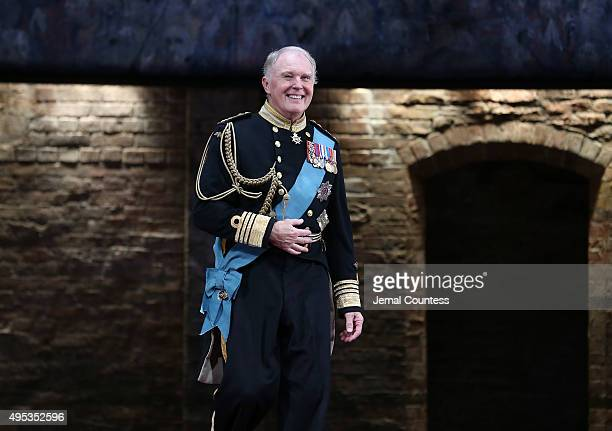 Actor Tim PigottSmith takes a bow during curtain call for the Broadway Opening Night of 'King Charles III' at the Music Box Theatre on November 1...