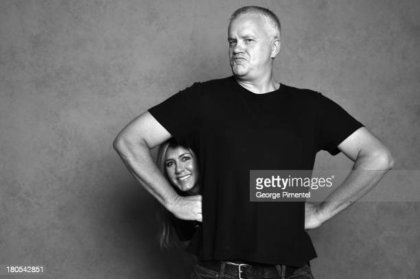 Actor Tim Robbins and actress/producer Jennifer Aniston of 'Life of Crime' pose at the Guess Portrait Studio during 2013 Toronto International Film...