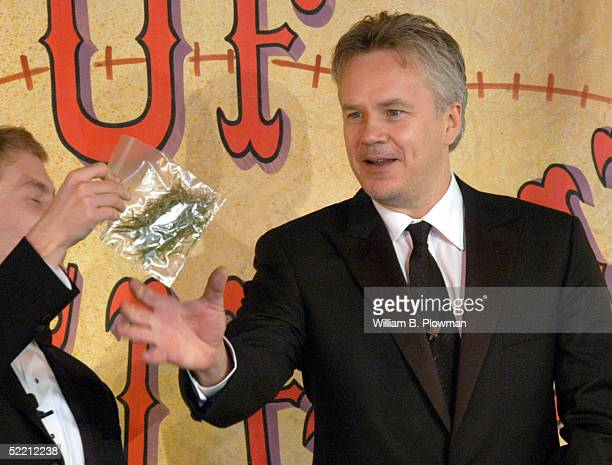Actor Tim Robbins reaches for a mock bag of marijuana during ceremonies at Harvard University's Hasty Pudding Theatricals 'Man of the Year' on...
