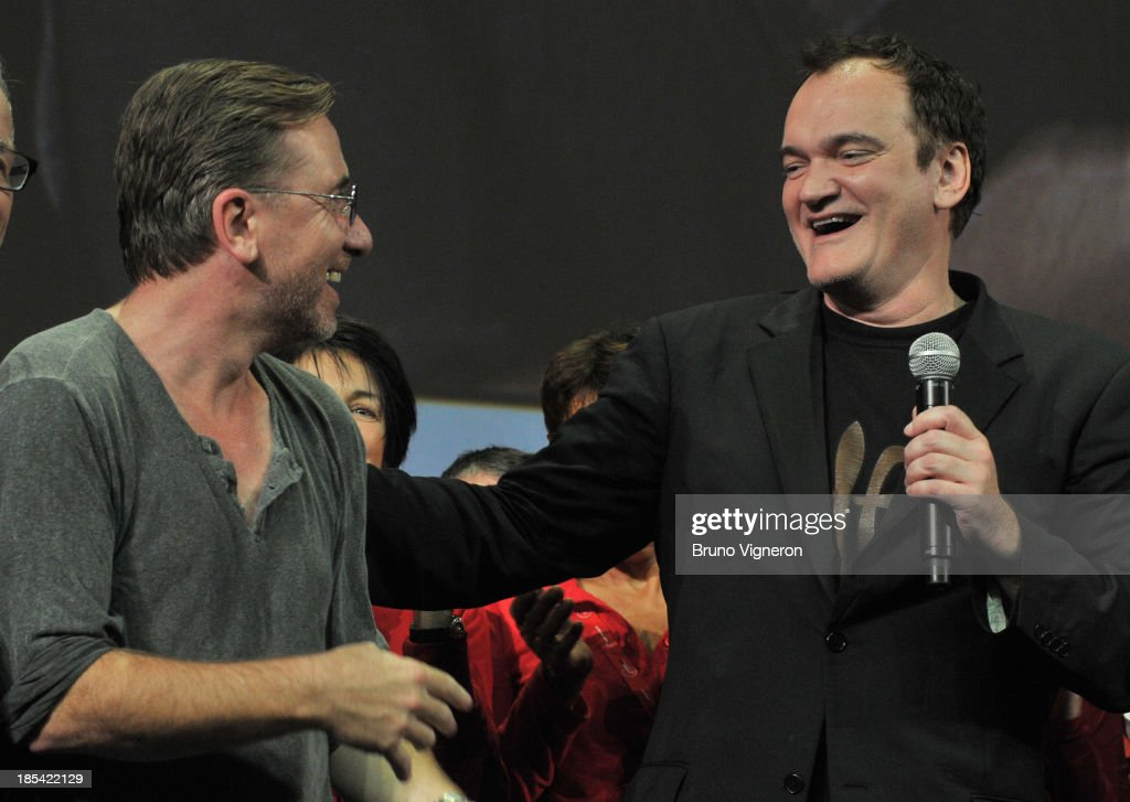 Actor Tim Roth (L) and director Quentin Tarantino (C) on stage during the closing ceremony of 'Lumiere 2013, Grand Lyon Film Festival' on October 20, 2013 in Lyon, France.