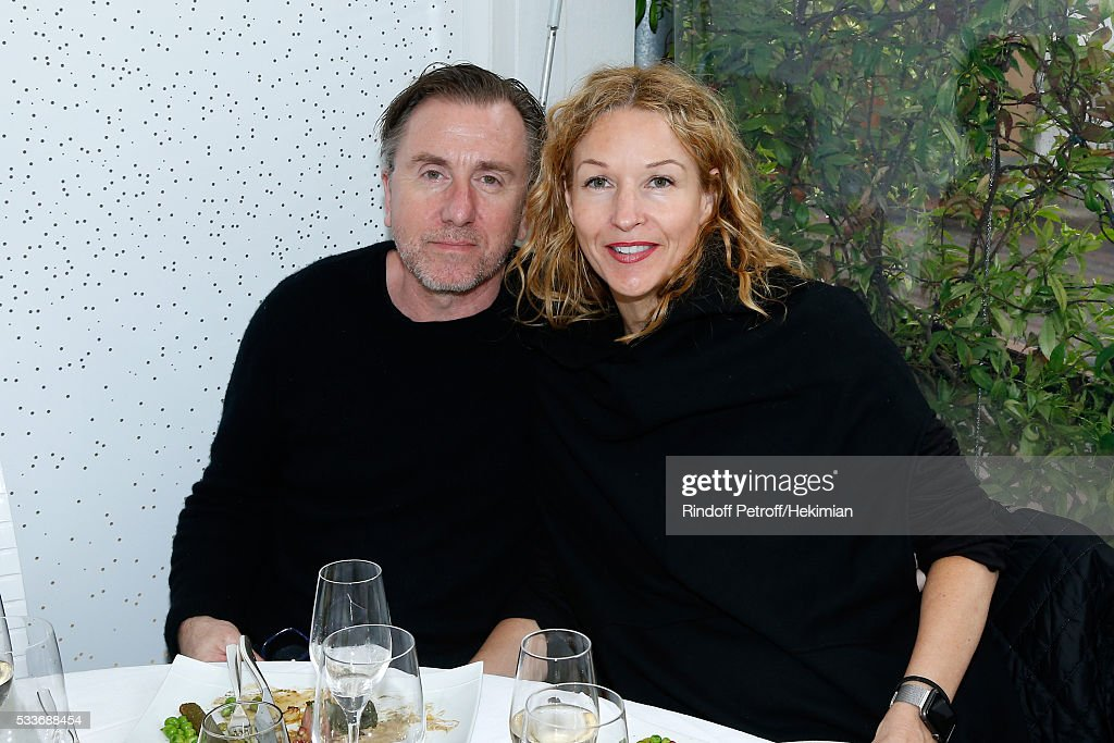 Actor Tim Roth and his wife Nikki Butler attend the 2016 French Tennis Open - Day Two at Roland Garros on May 23, 2016 in Paris, France.