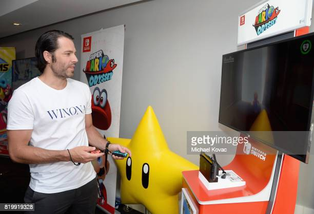 Actor Tim Rozon from the television series 'Wynonna Earp' stopped by Nintendo at the TV Insider Lounge to check out Nintendo Switch during ComicCon...