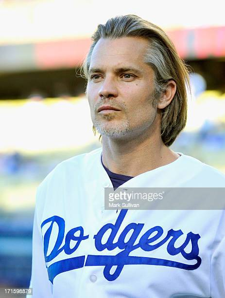 Actor Timothy Olyphant on the field prior to throwing out the ceremonial first pitch before the game between the Los Angeles Dodgers and the San...