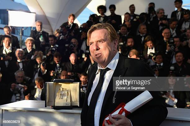 Actor Timothy Spall poses with his Best Actor award for his role in the film 'Mr Turner' as he attends the Palme D'Or Winners photocall during the...