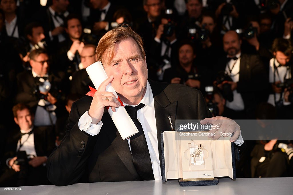 Actor Timothy Spall poses with his Best Actor award for his role in the film 'Mr. Turner' at the Winners photocall during 67th Cannes Film Festival