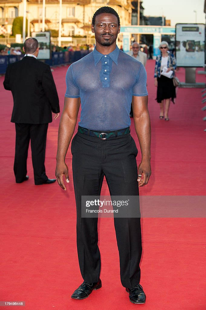 Actor Tishuan Scott arrives at the premiere of the film 'Parkland' during the 39th Deauville American Film Festival on September 4, 2013 in Deauville, France.