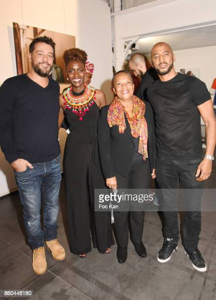 Actor Titoff Rokhaya Diallo former minister Christiane Taubira and rap artist/actor Stomy Bugsy attend the 'Afro' Rokhaya Diallo and photographer...