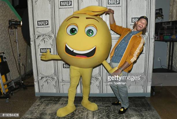 Actor TJ Miller an Gene the emoji attend Build to discuss their new movie 'The Emoji Movie' at Build Studio on July 19 2017 in New York City