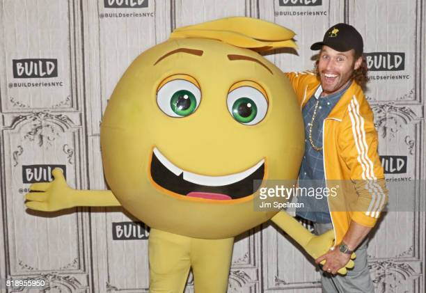 Actor TJ Miller and Gene the emoji attend Build to discuss their new movie 'The Emoji Movie' at Build Studio on July 19 2017 in New York City