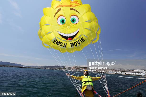 Actor TJ Miller parasails to 'The Emoji Movie' photo call at the start of the 70th Cannes Film Festival at The Carlton Pier on May 16 2017 in Cannes...
