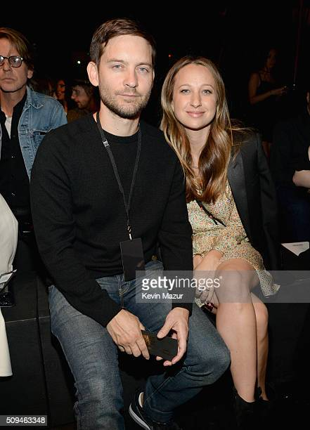 Actor Tobey Maguire and designer Jennifer Meyer in Saint Laurent by Hedi Slimane attend Saint Laurent at the Palladium on February 10 2016 in Los...