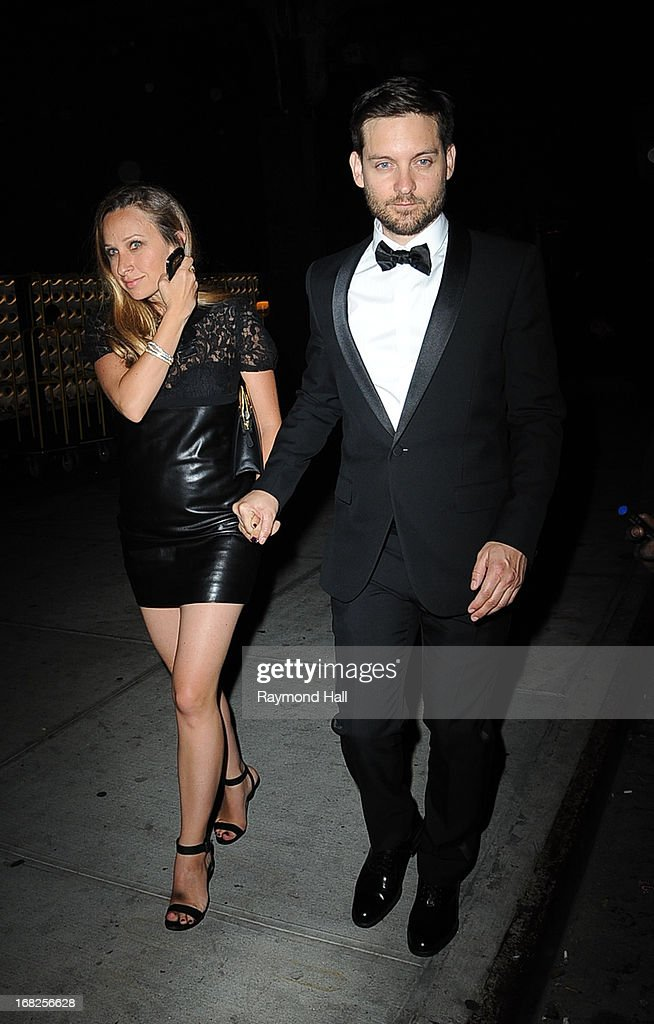 Actor Tobey Maguire (R) and Jennifer Meyer leave the 'PUNK: Chaos To Couture' Costume Institute Gala after party at the Standard Hotel on May 6, 2013 in New York City.