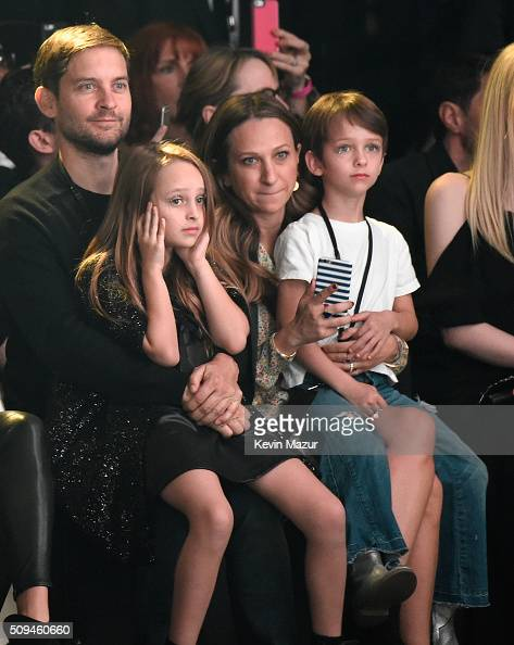 Actor Tobey Maguire Ruby Maguire designer Jennifer Meyer in Saint Laurent by Hedi Slimane and Otis Tobias Maguire attend Saint Laurent at the...