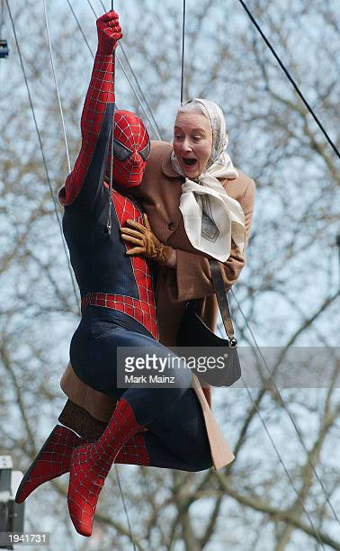 Actor Tobey Maguire's stunt double and actress Rosemary Harris film a scene of the upcoming movie 'The Amazing SpiderMan' near City Hall April 20...