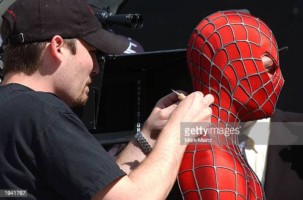 Actor Tobey Maguire's stunt double prepares to film a scene on the set of the upcoming movie 'The Amazing SpiderMan' near City Hall April 20 2003 in...