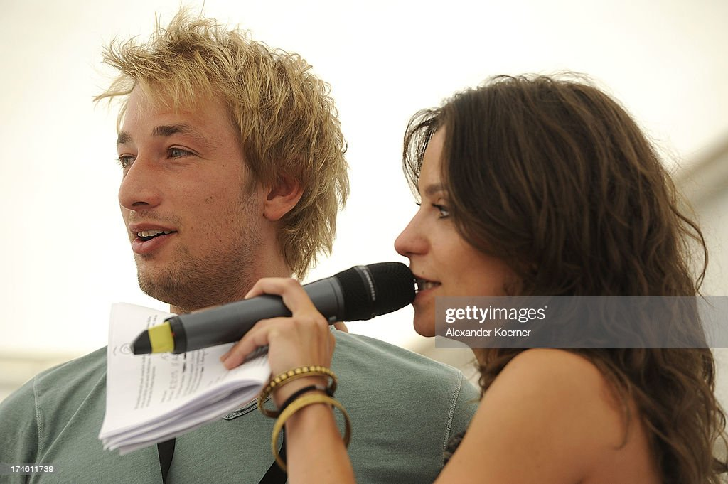 Actor Tobias Rosen and Actress Anika Lehmann are beeing pictured during the 'Rote Rosen Fan-Tag 2013' on July 28, 2013 in Luneburg, Germany. More than 3500 fans of the daily television telenovela 'Rote Rosen' came to see the Studios and to meet their favorite actor.